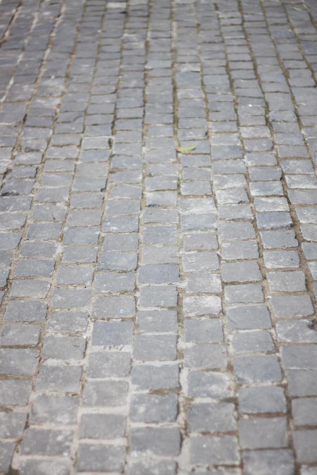 grauer Kopfsteinpflasterweg foto