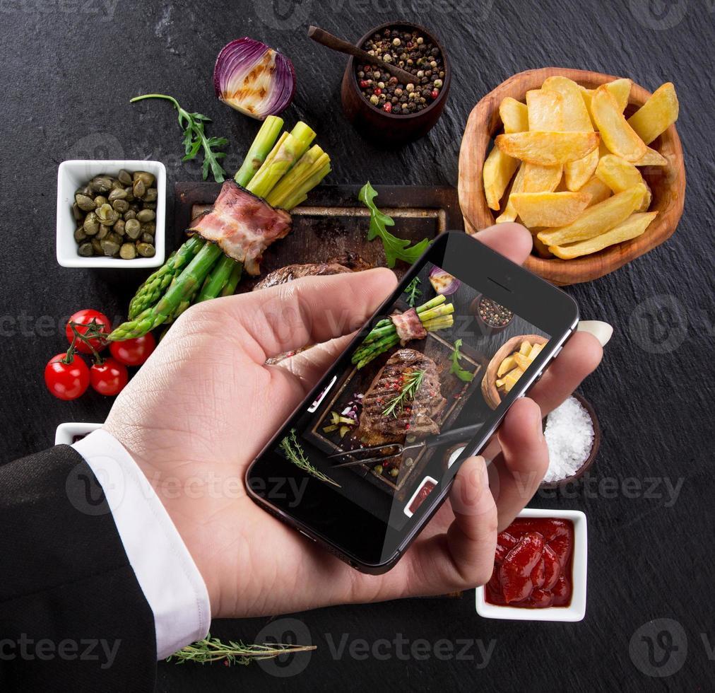 Smartphone schoss Lebensmittel Foto