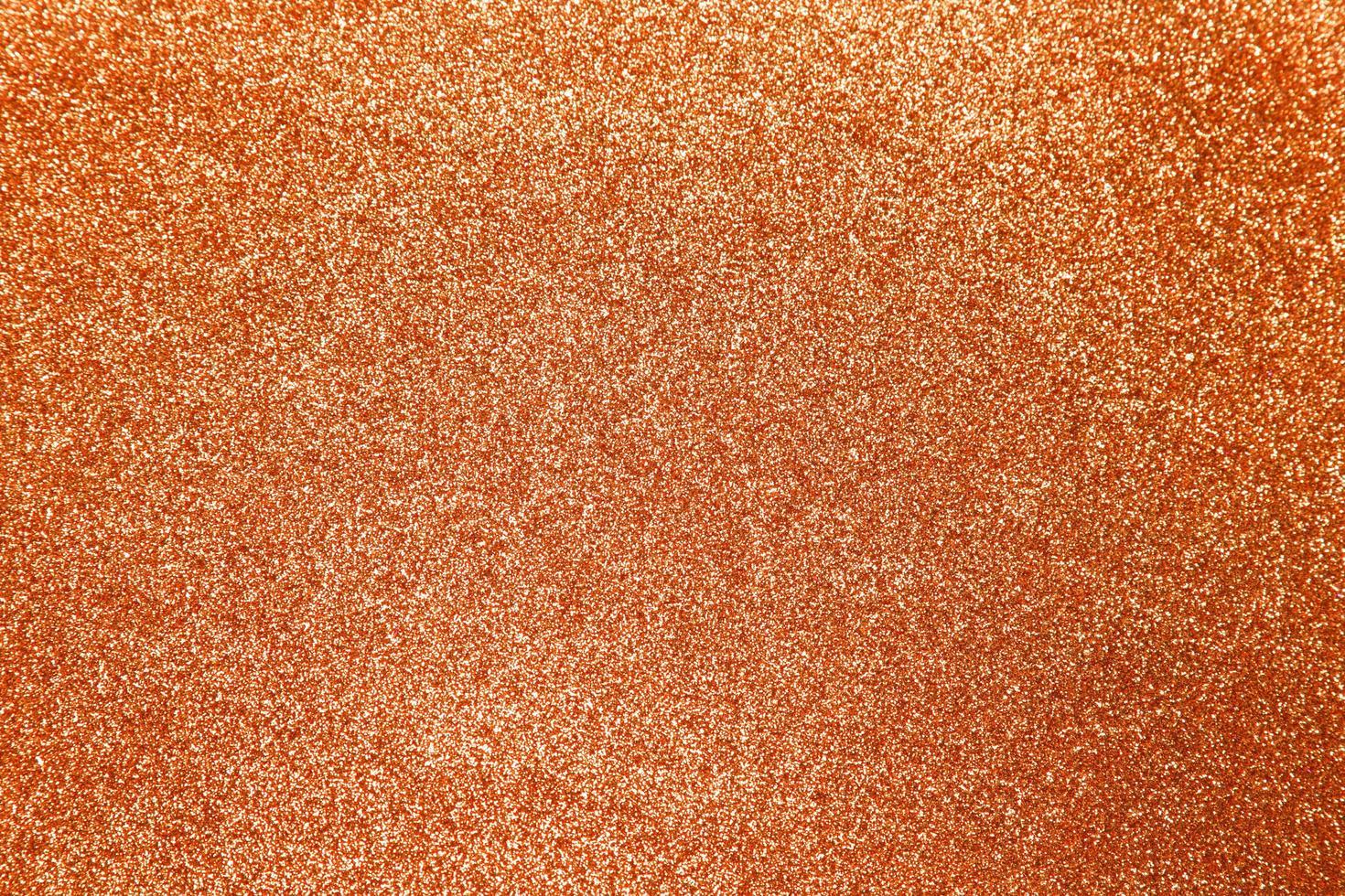 orange glitzernder glänzender Texturhintergrund foto
