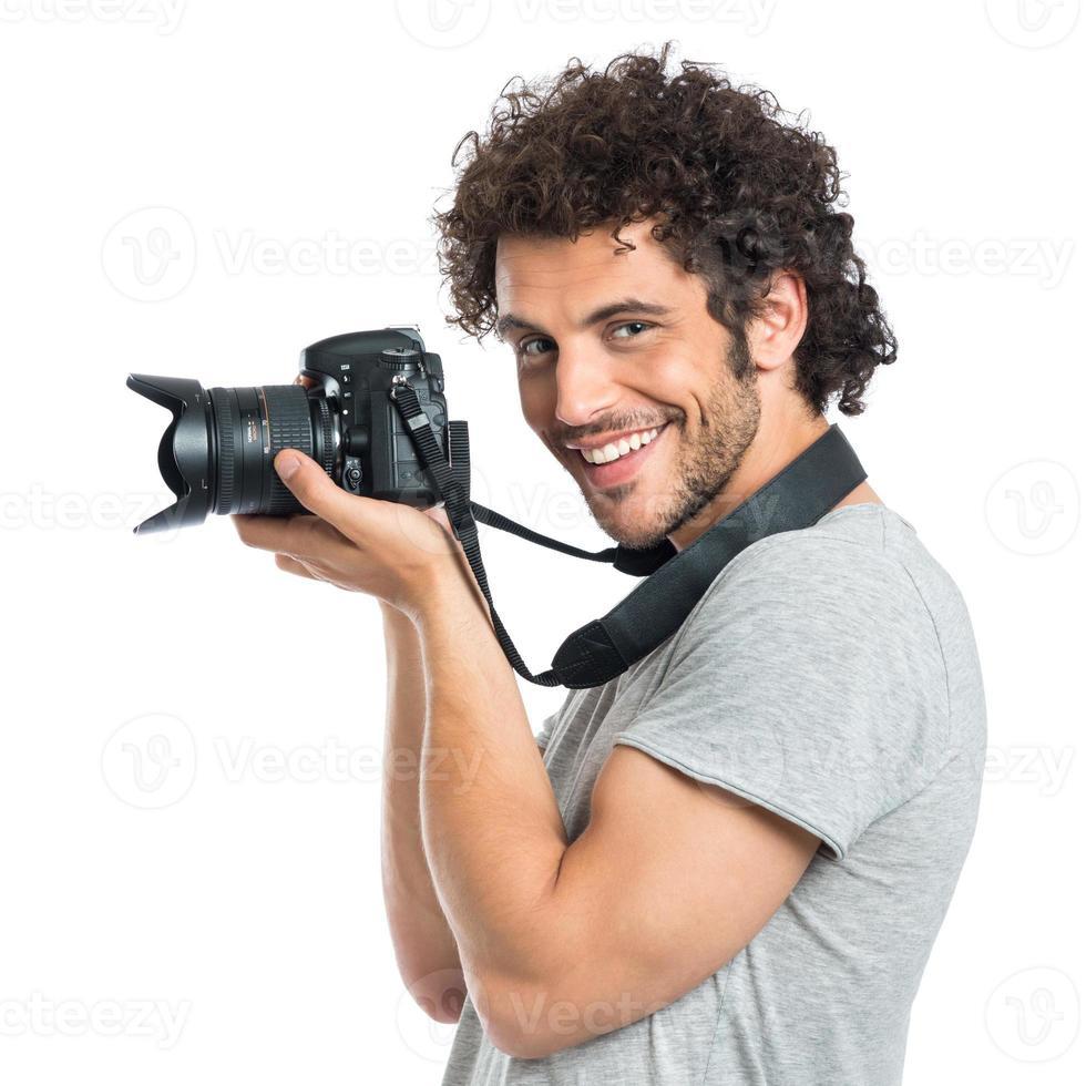 junger Mann hält Reflex foto