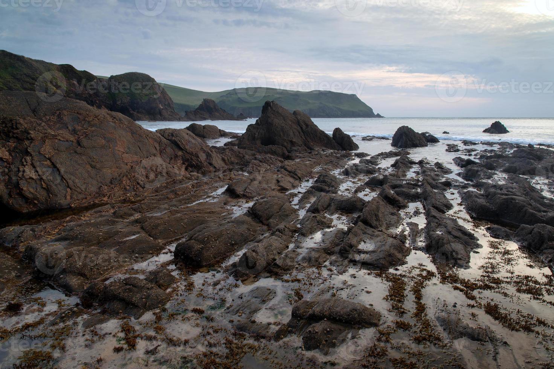 Hoffnung Bucht Sonnenuntergang Landschaft Seelandschaft mit felsigen Küste foto