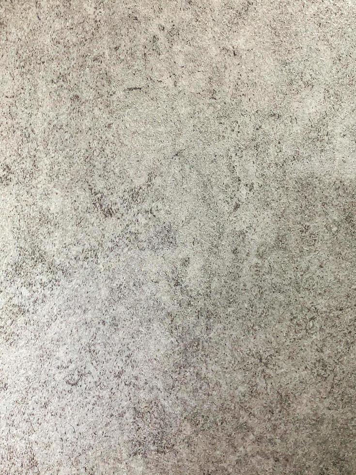 zufälliger grauer nackter konkreter Hintergrund foto