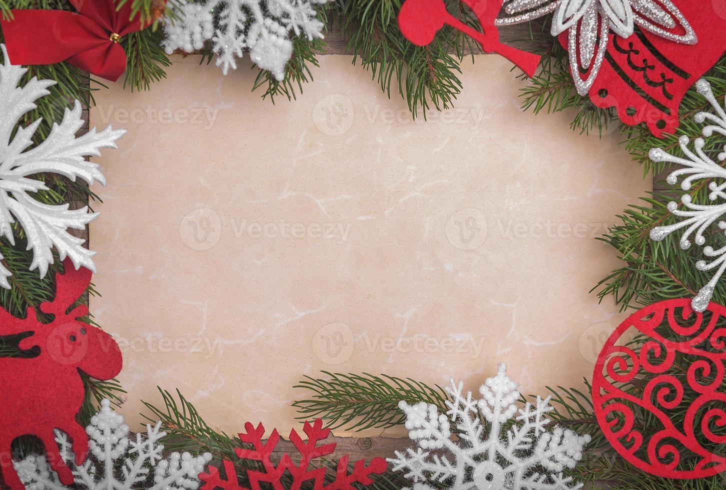Weihnachtsrahmen mit einem Blatt Papier foto