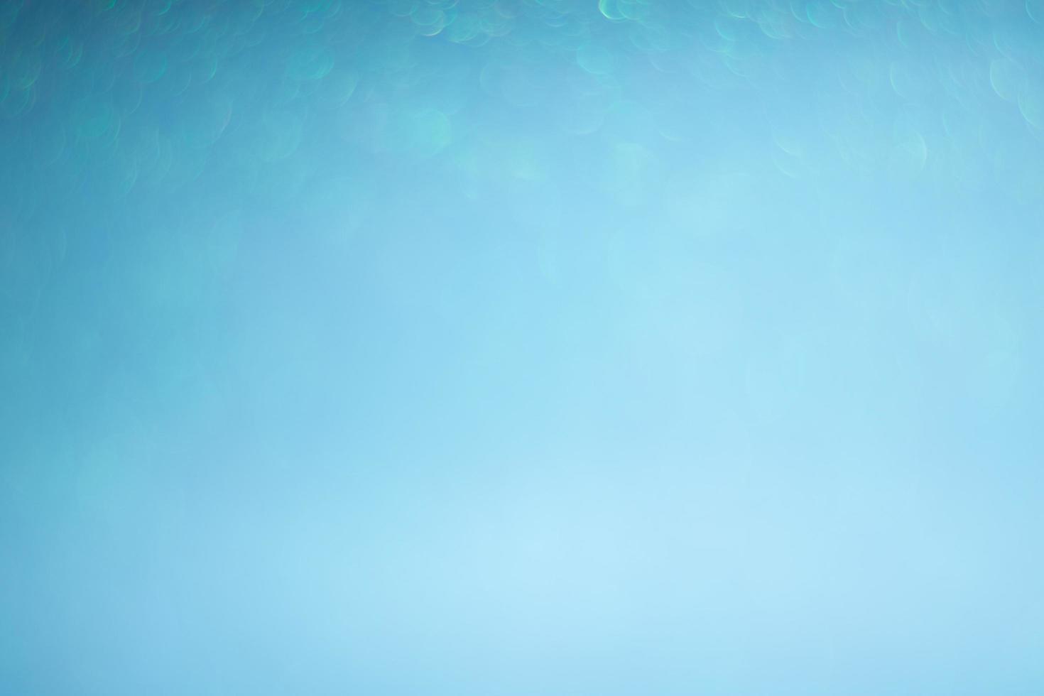 abstrakter blauer Bokehhintergrund foto