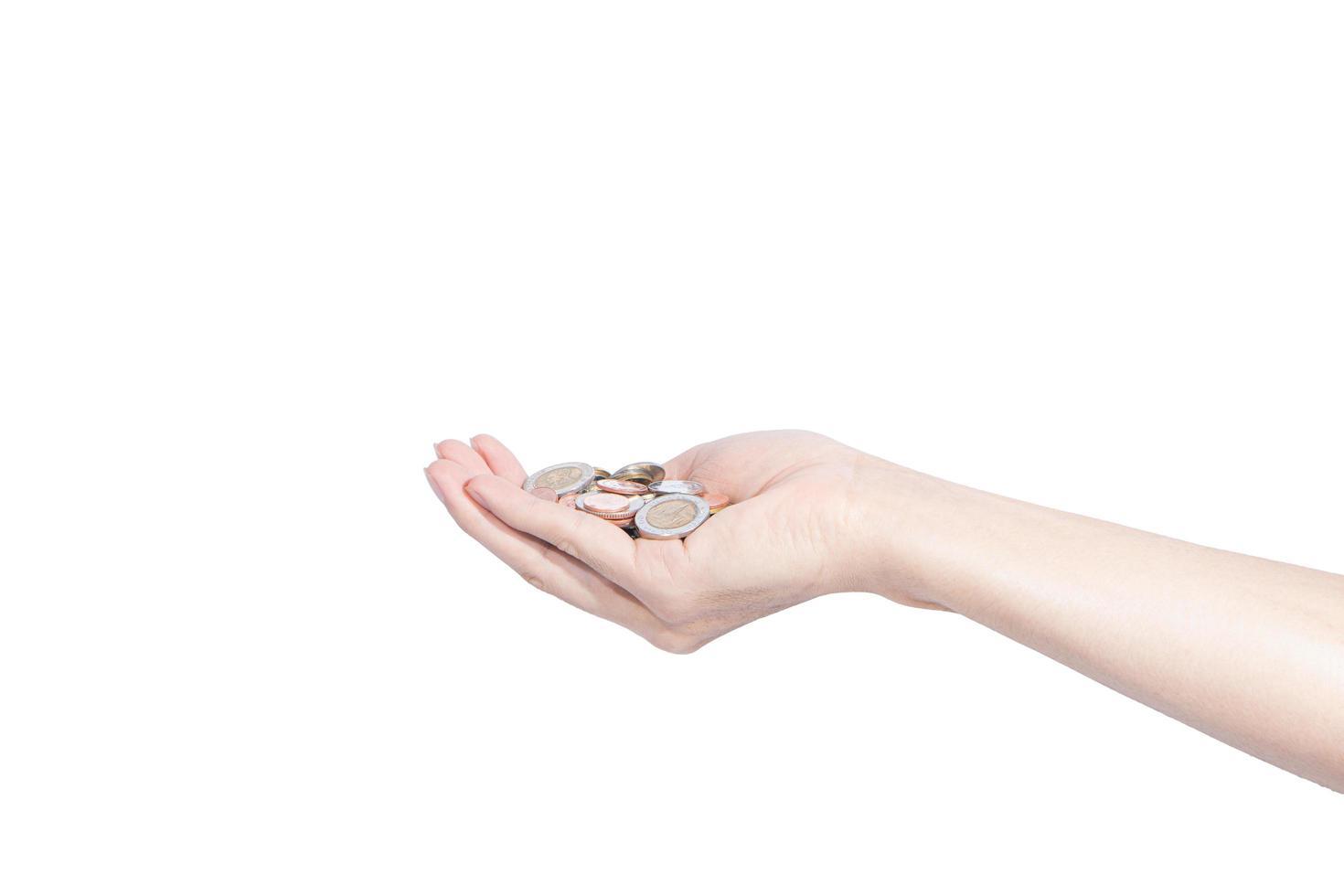 Münzen in einer Hand foto
