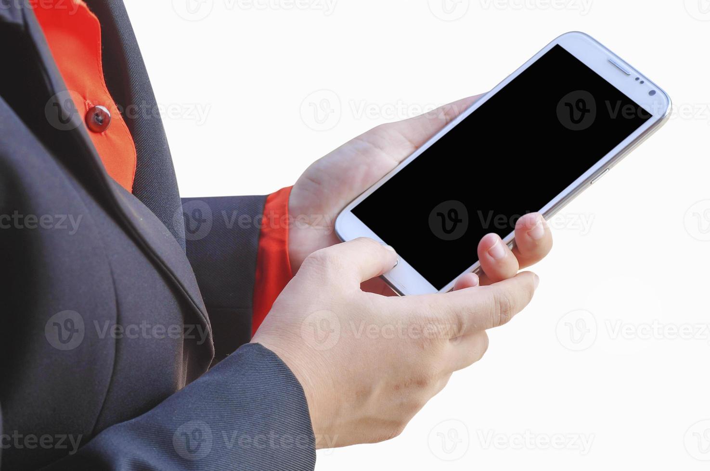 Person, die ein Mobiltelefon hält foto