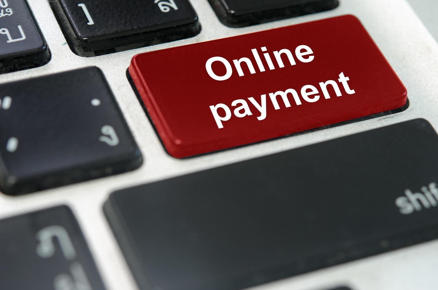 roter Online-Zahlungsknopf foto