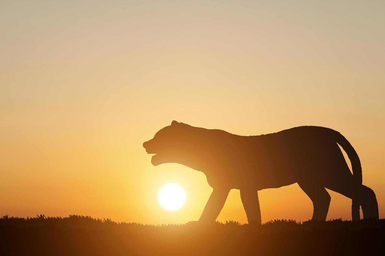 Silhouette Tiger auf Sonnenuntergang Hintergrund foto