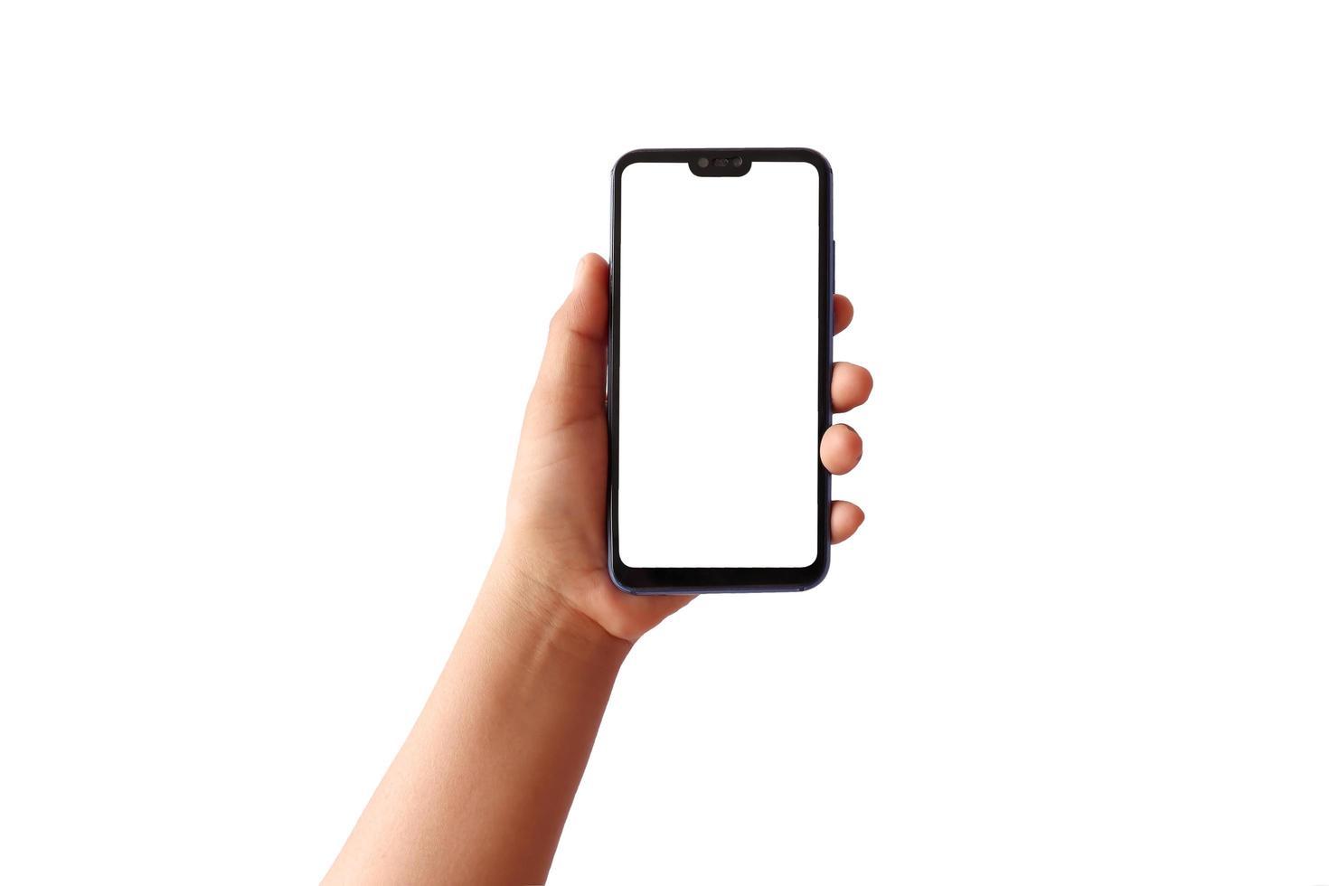 Die Hand hält den weißen Bildschirm, das Mobiltelefon ist auf einem weißen Hintergrund mit dem Beschneidungspfad isoliert foto
