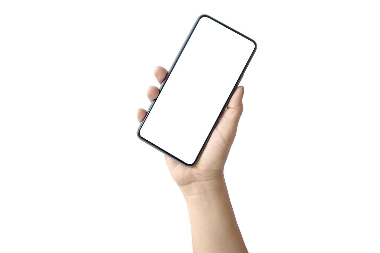 Hand hält ein leeres Bildschirm-Smartphone lokalisiert auf weißem Hintergrund mit dem Beschneidungspfad foto