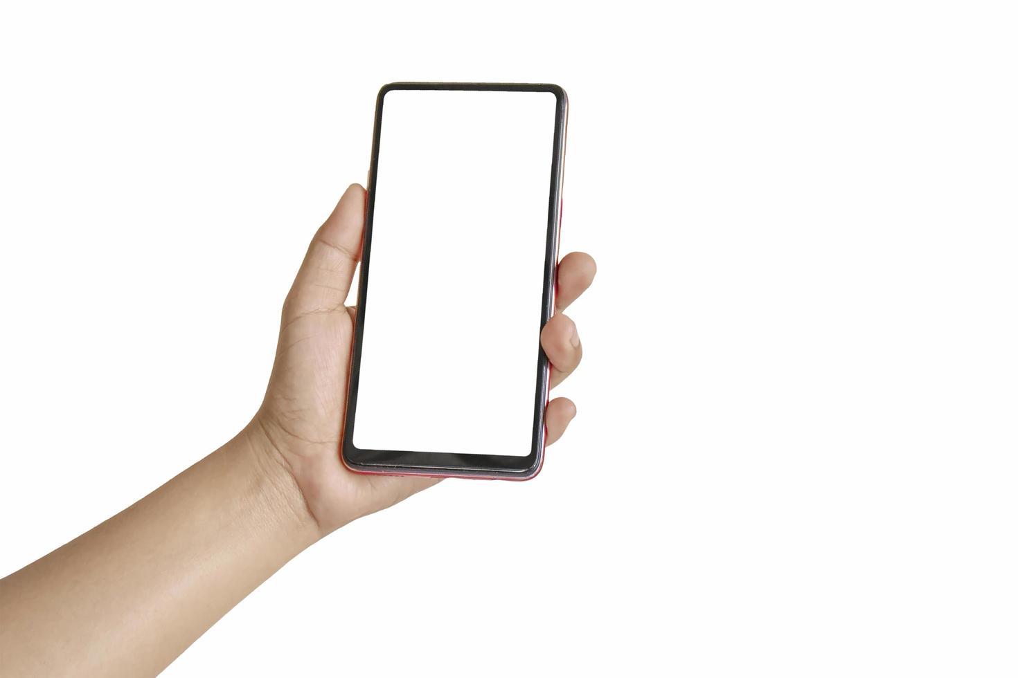 Die Hand hält den weißen Bildschirm, das Mobiltelefon ist auf einem weißen Hintergrund isoliert foto