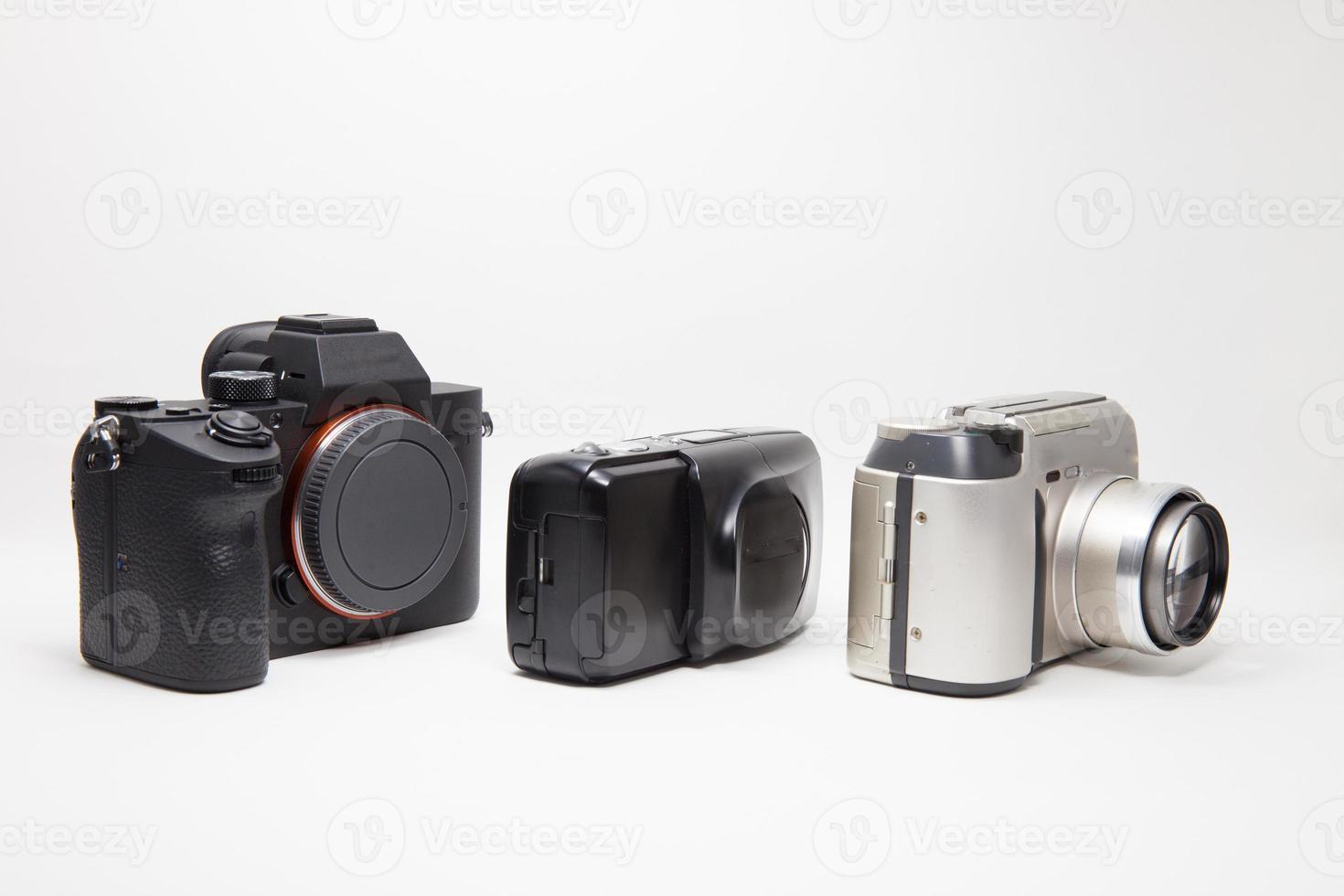 drei Kameras auf Weiß foto