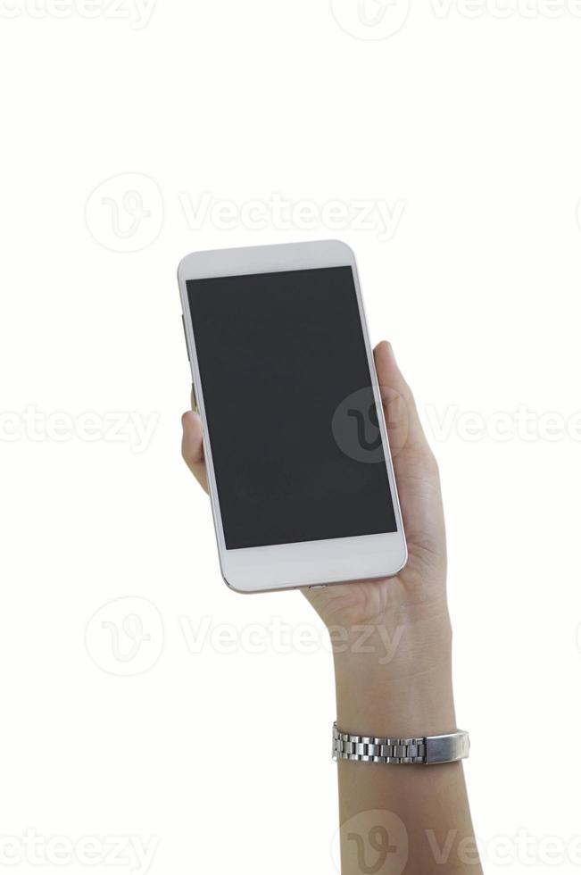Frauenhand, die ein weißes Telefon auf weißem Hintergrund hält foto