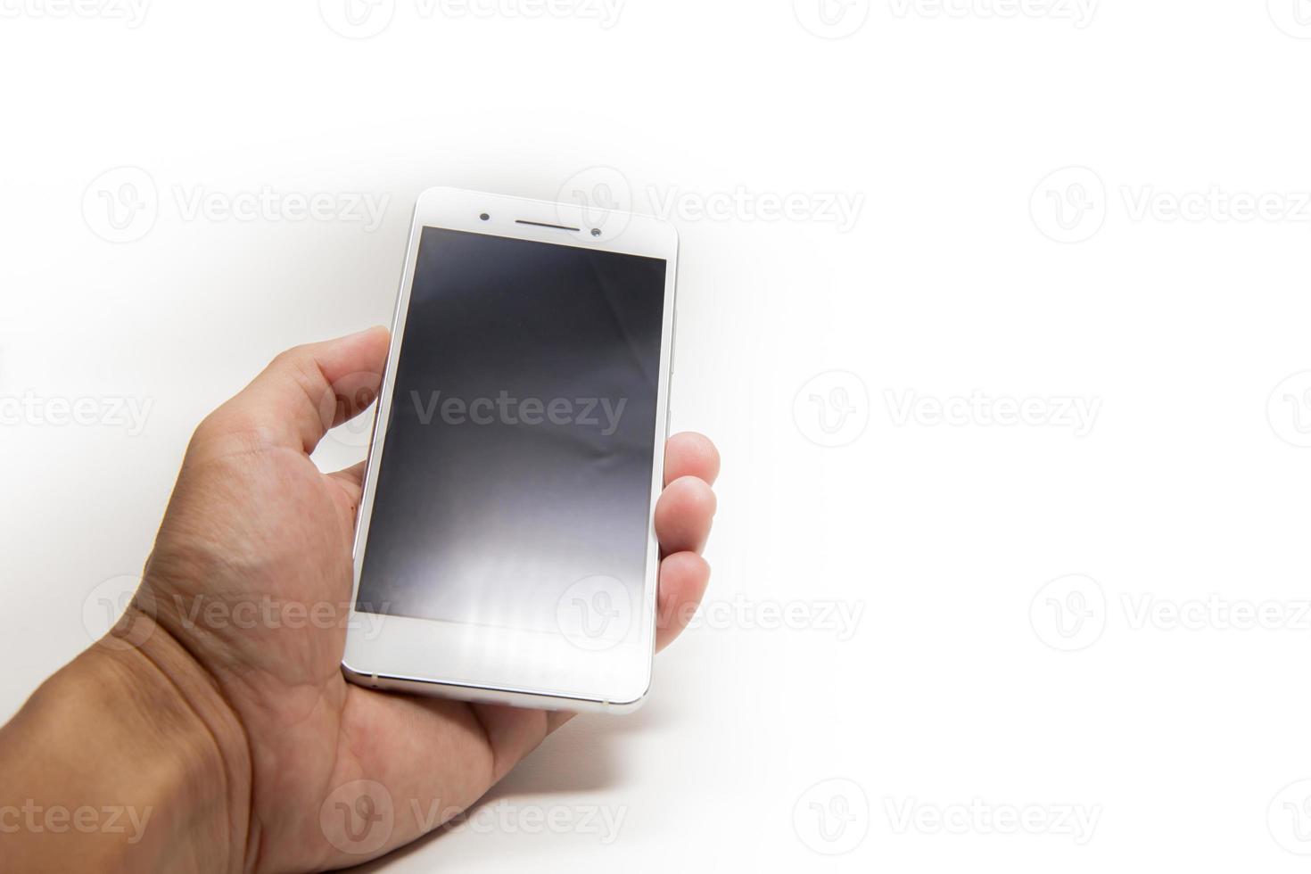 Hand hält ein Smartphone foto