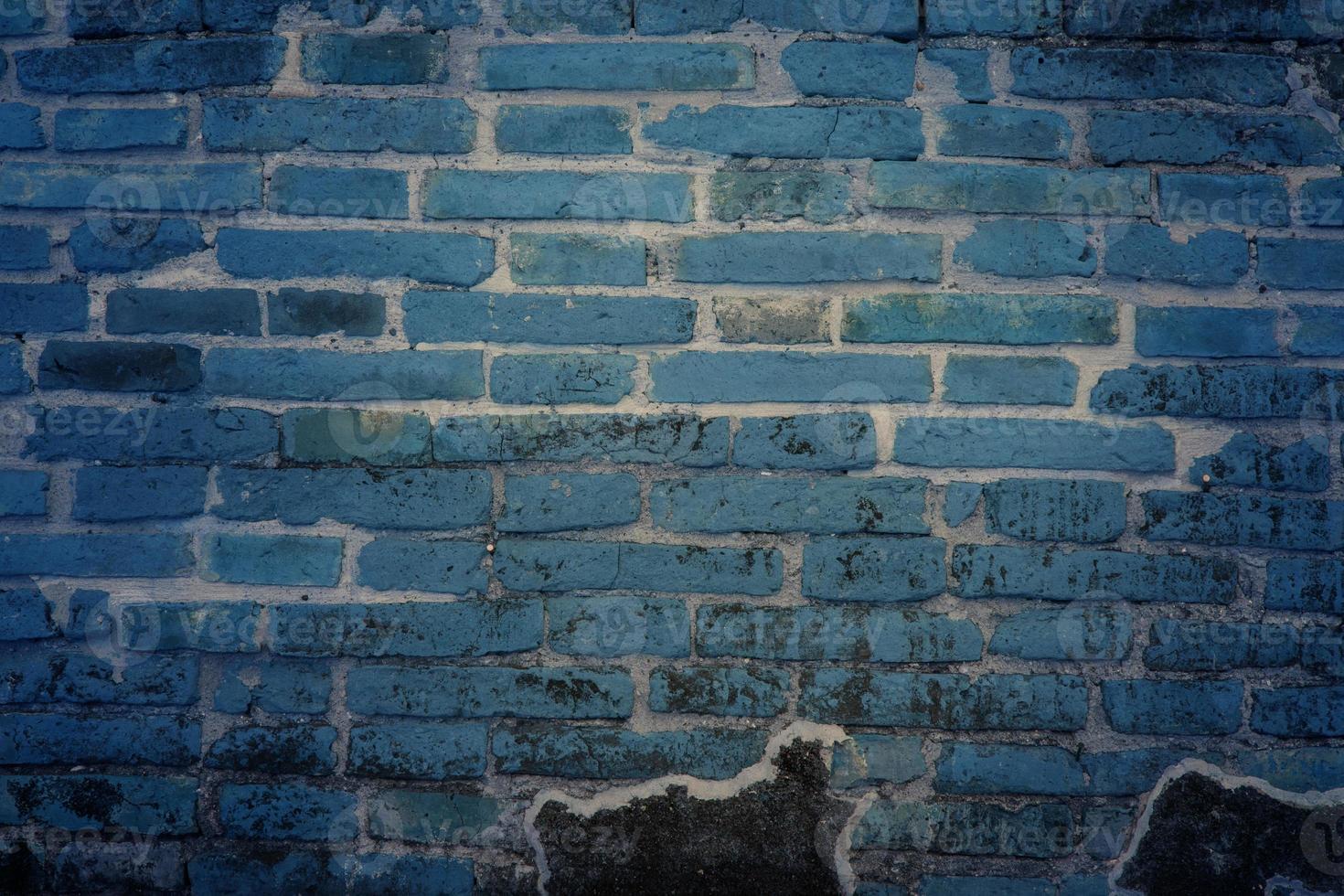 dunkelblaue Backsteinmauer für Hintergrund oder Textur foto