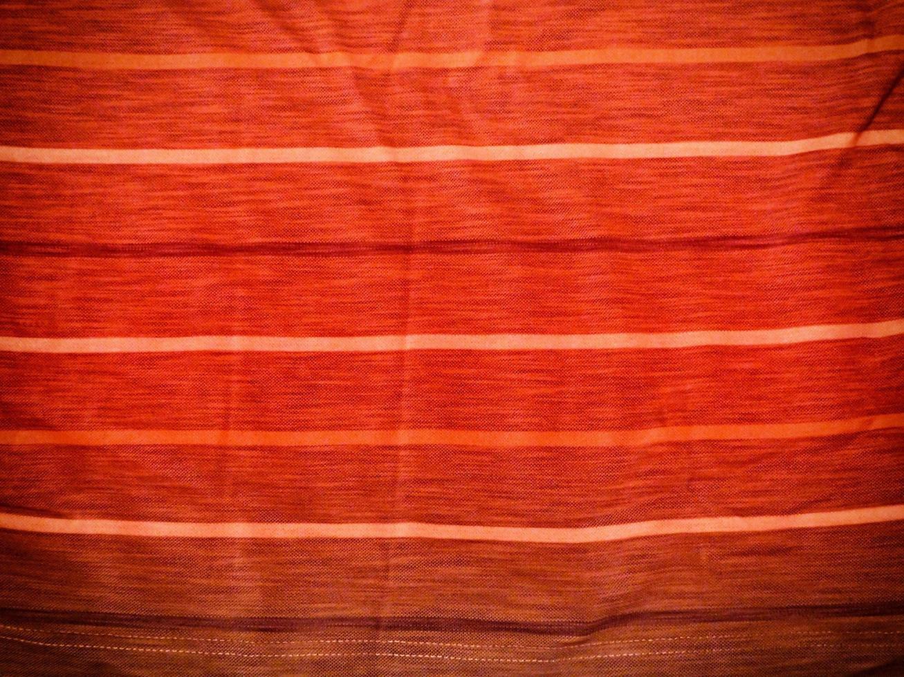 roter Stoff für Hintergrund oder Textur foto