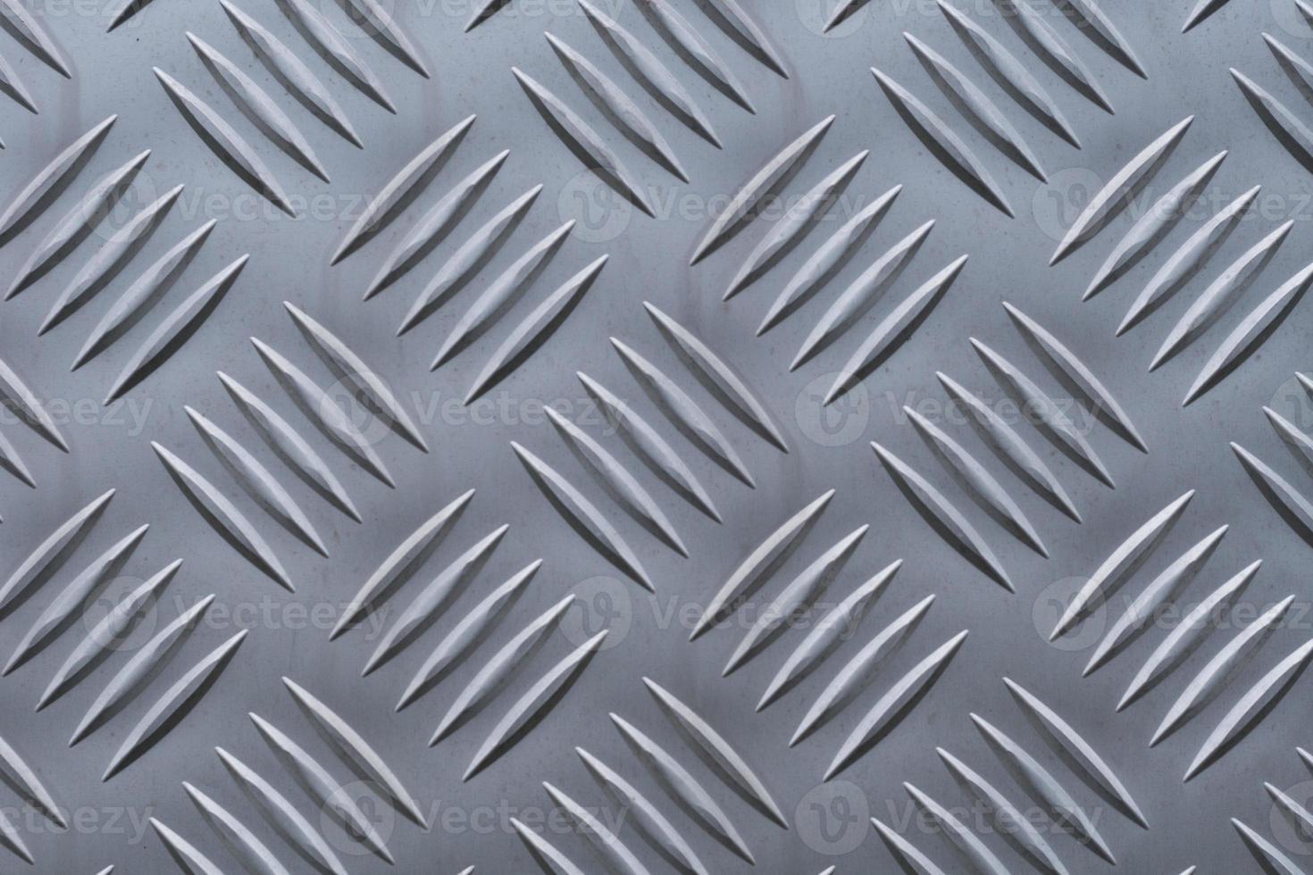 Hintergrund des Rautenmusters von einer Aluminiumplatte foto