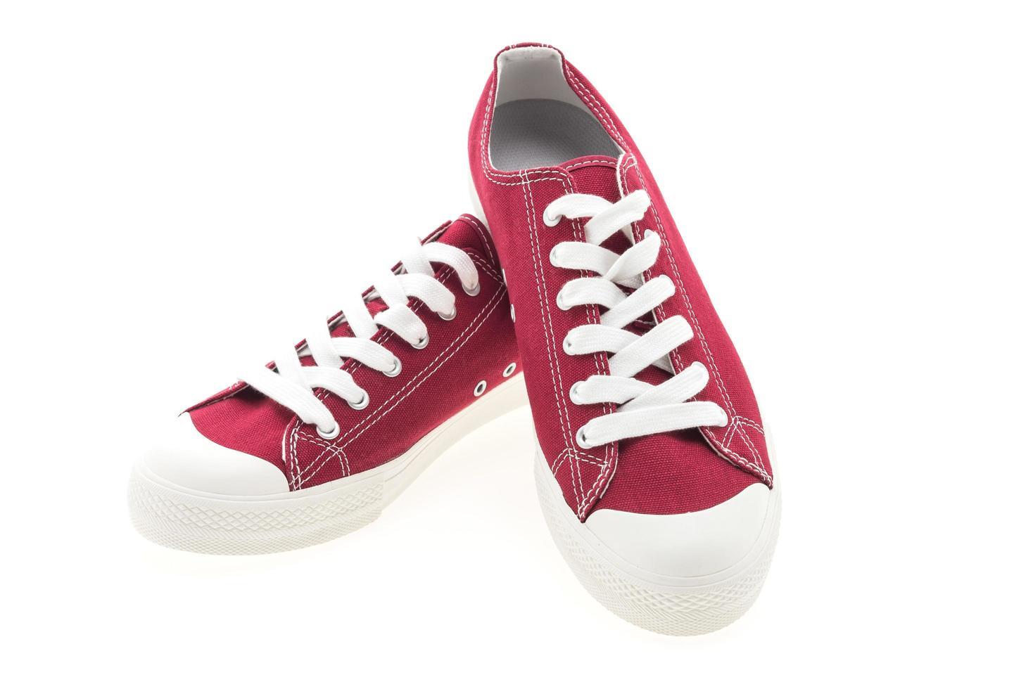 rote Schuhe auf weißem Hintergrund foto