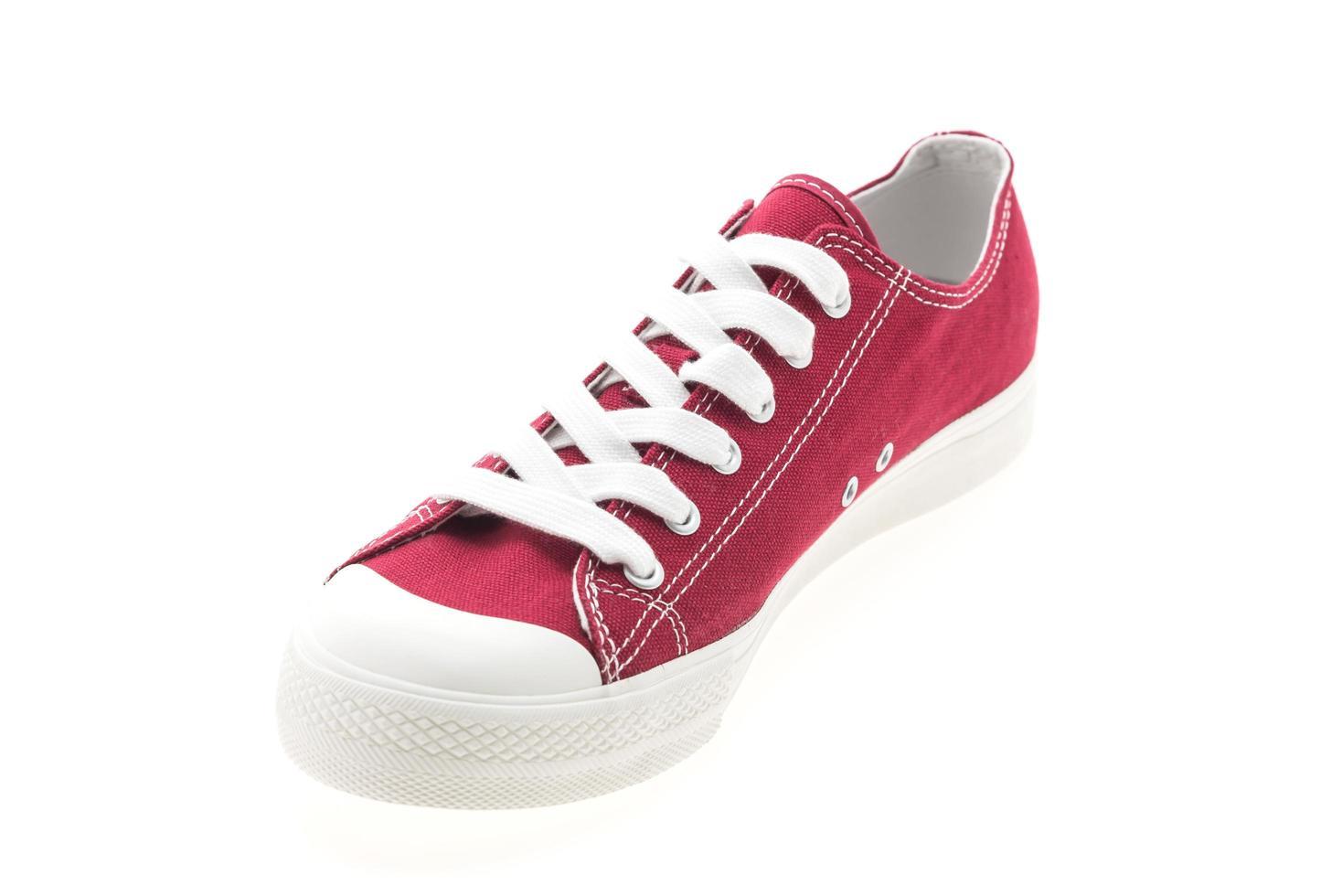 roter Schuh auf weißem Hintergrund foto