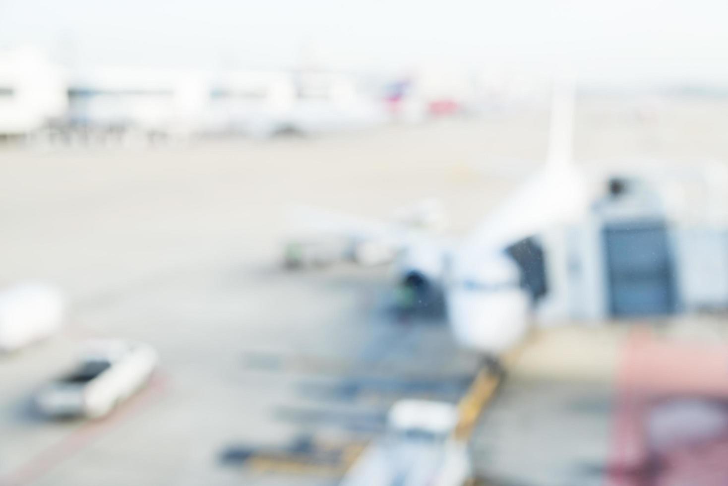 abstraktes Unschärfeflugzeug im Flughafen foto