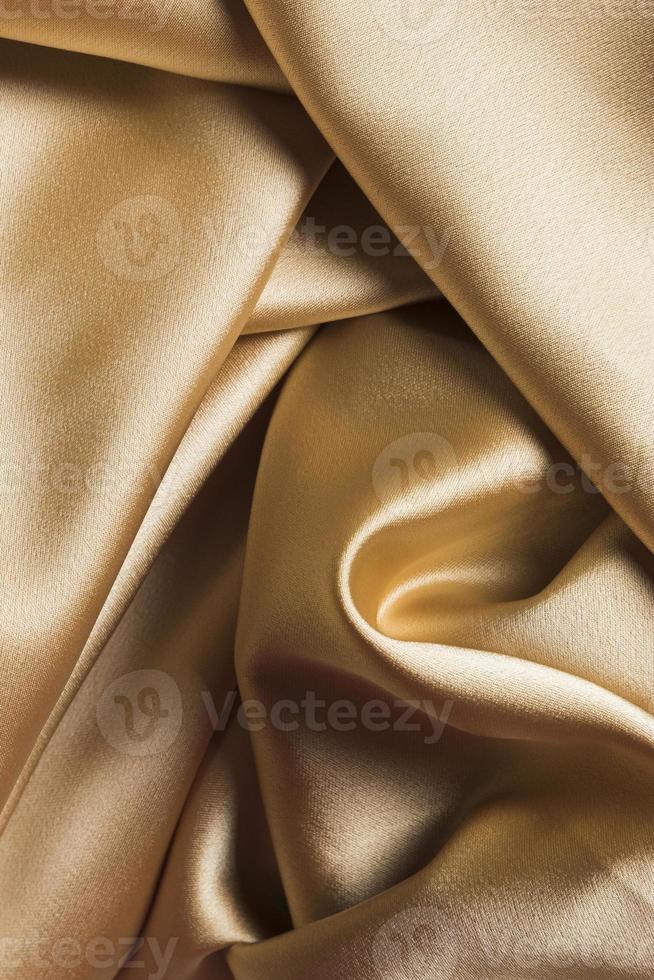 kurviges Golddekor Stoffmaterial foto