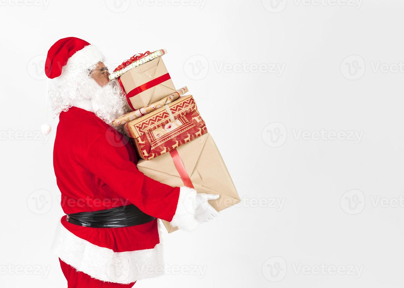 Weihnachtsmann bringt Weihnachtsgeschenke foto