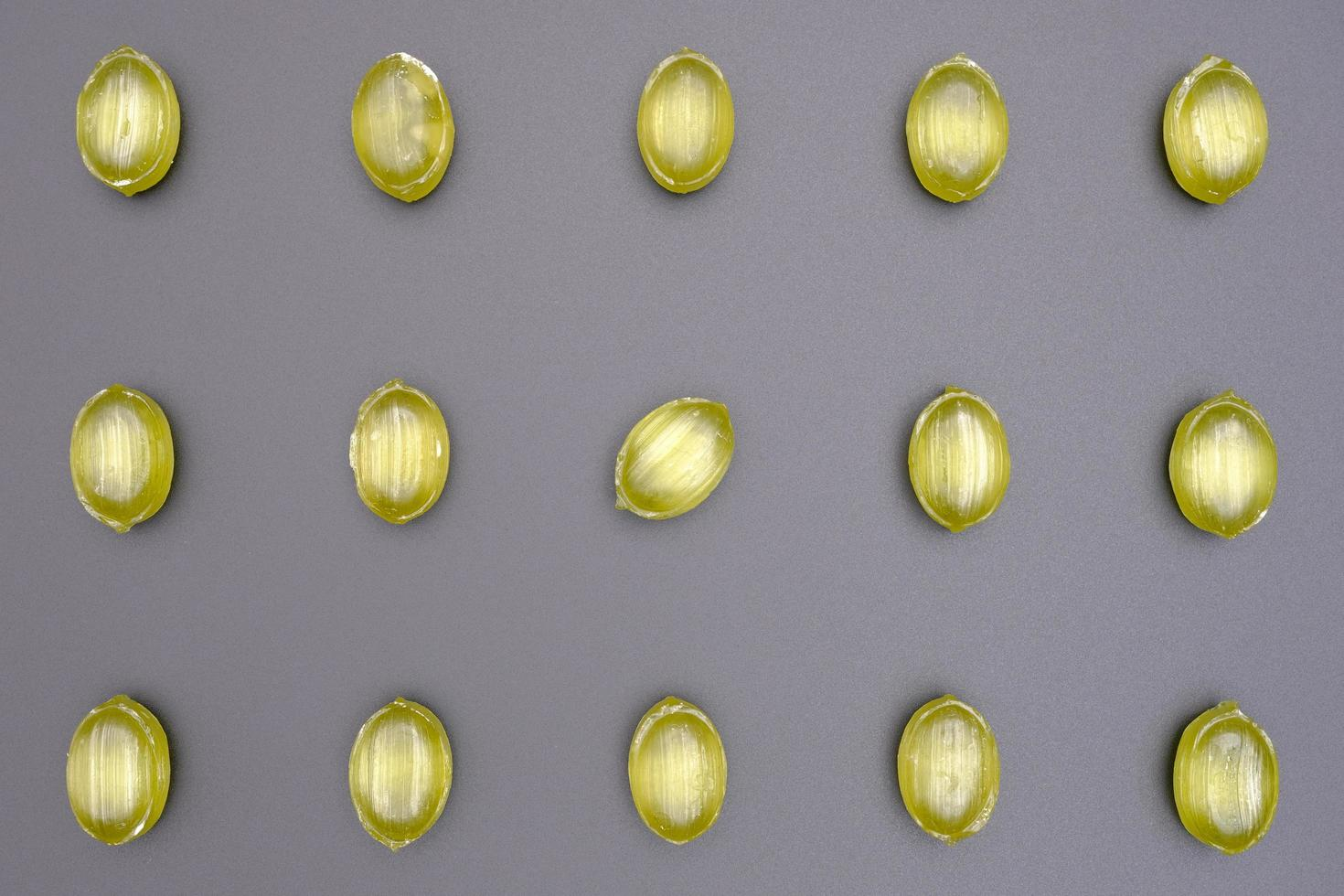 grüne ovale Form glänzendes Karamell Bonbons Muster foto