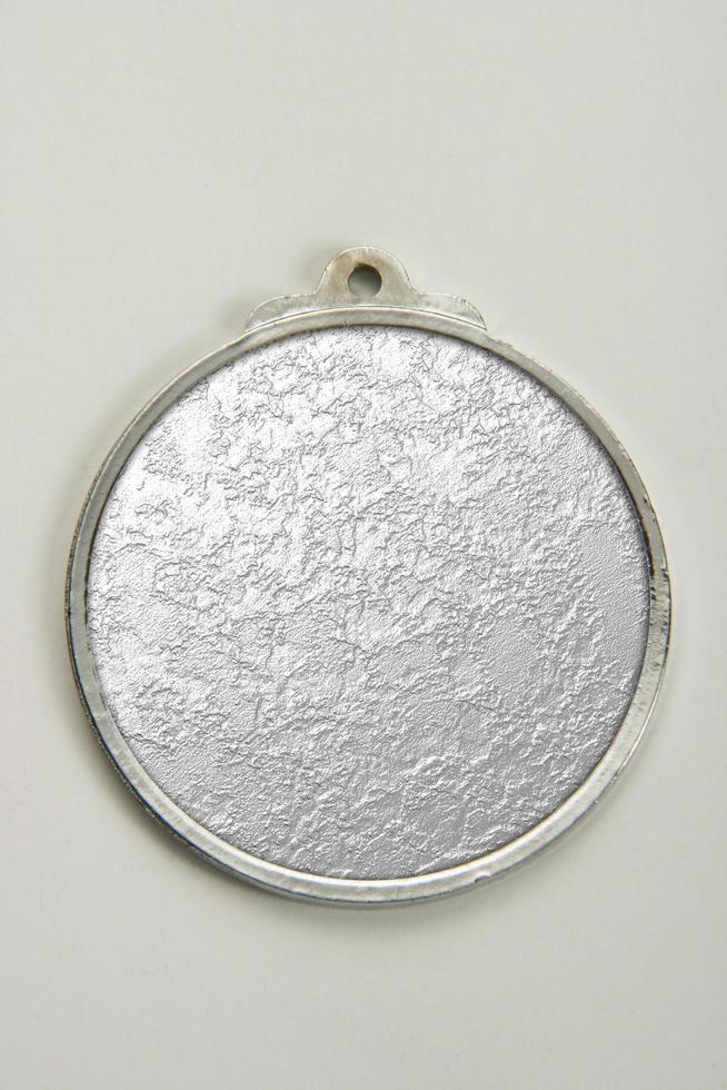 Medaillon aus Gold, Silber und Bronze foto
