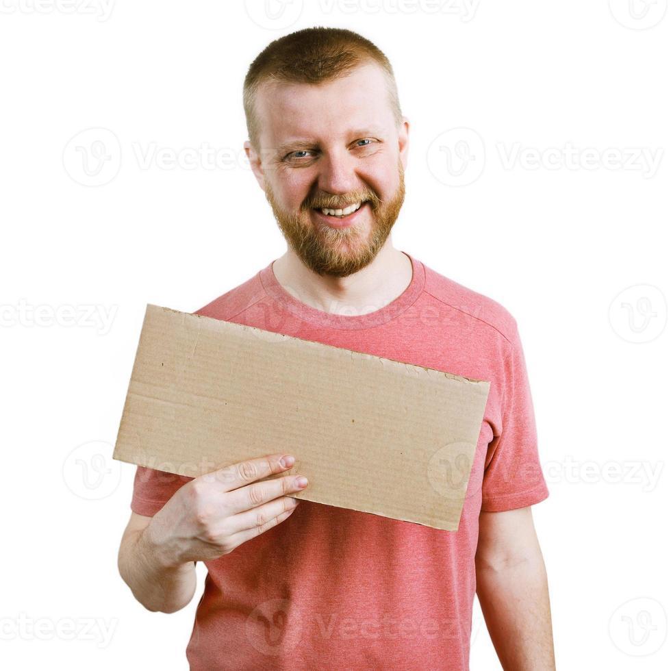 lustiger Mann mit einem Pappschild foto