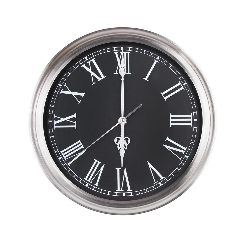sechs Uhr auf der runden Uhr foto