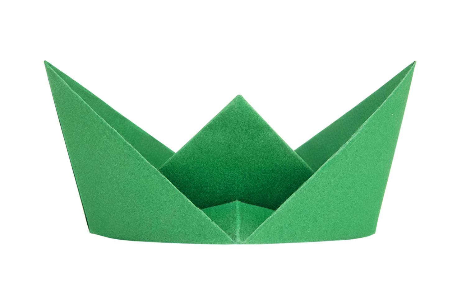 grünes Papierboot foto
