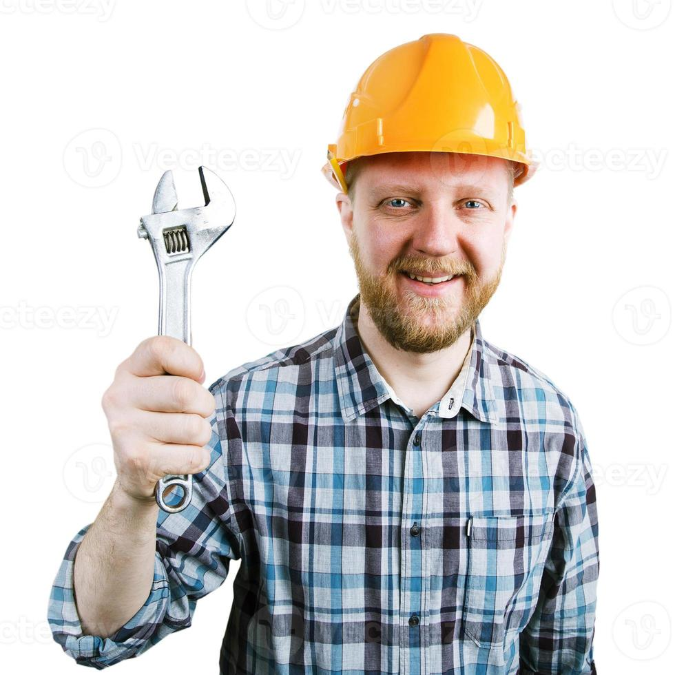 Mann mit einem Schraubenschlüssel in der Hand foto