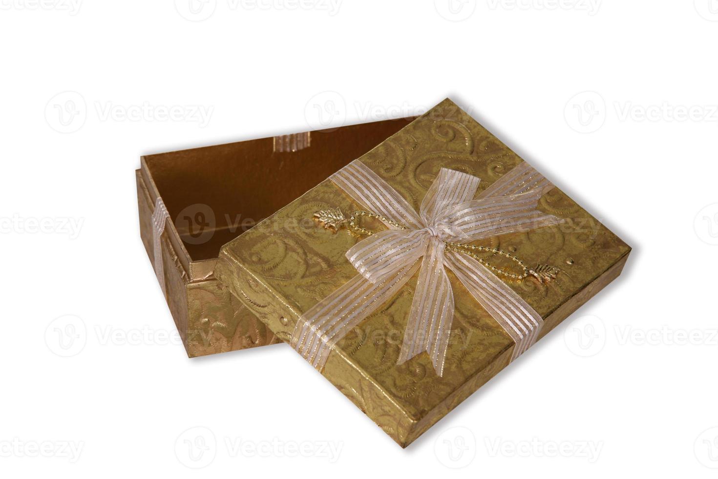 Goldpaket auf Weiß foto