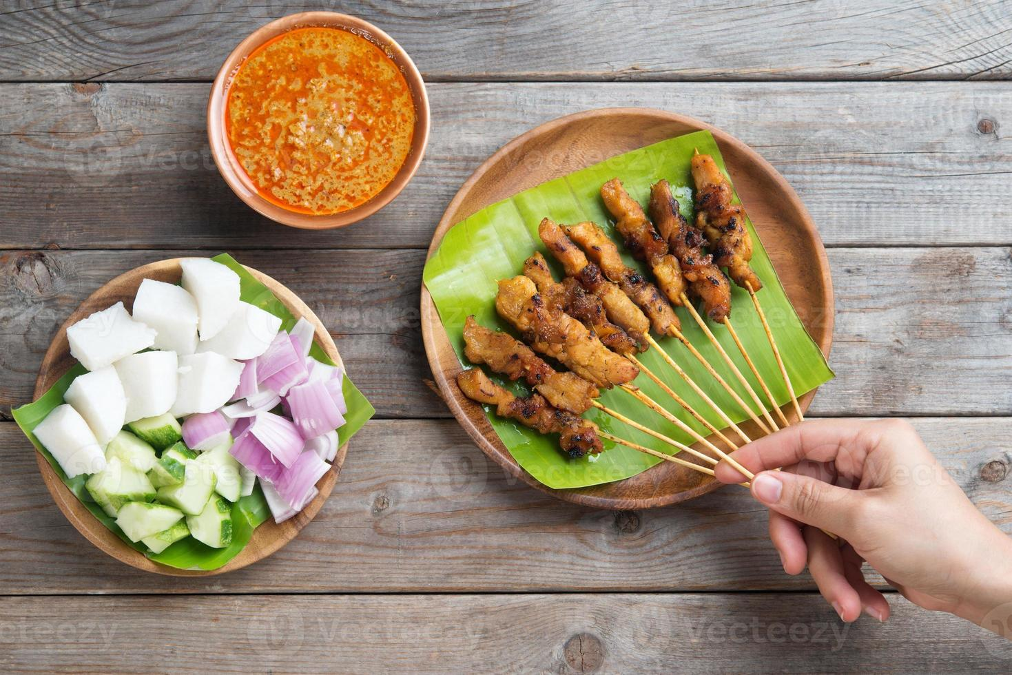 Leute, die Satay essen foto