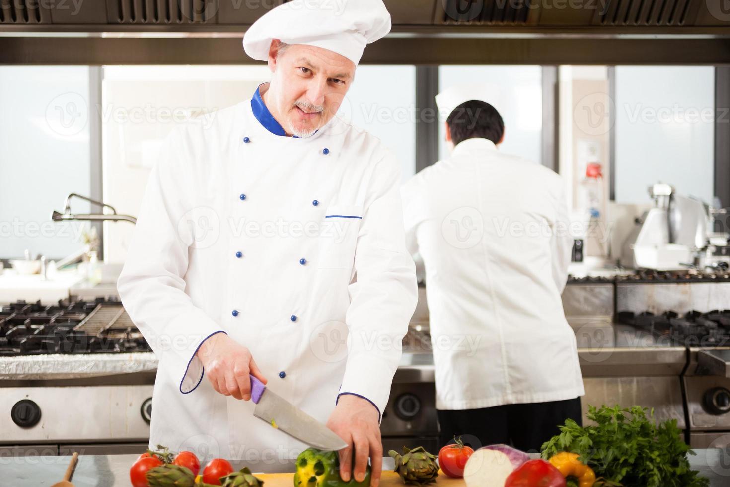 Koch bei der Arbeit foto