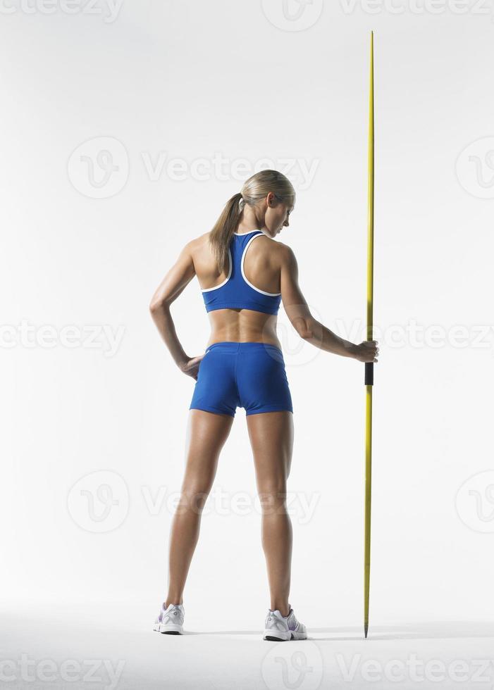 Sportlerin mit Speer foto