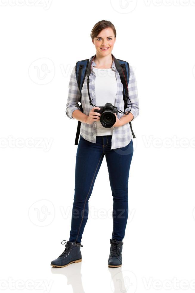 weiblicher Tourist, der auf Weiß steht foto