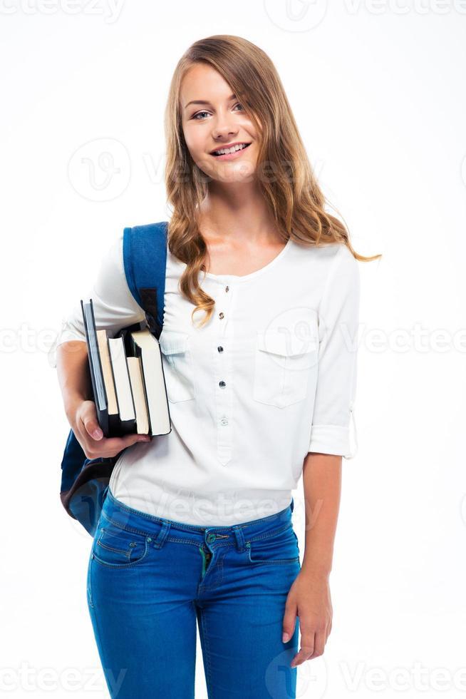 Studentin mit Rucksack, der Bücher hält foto