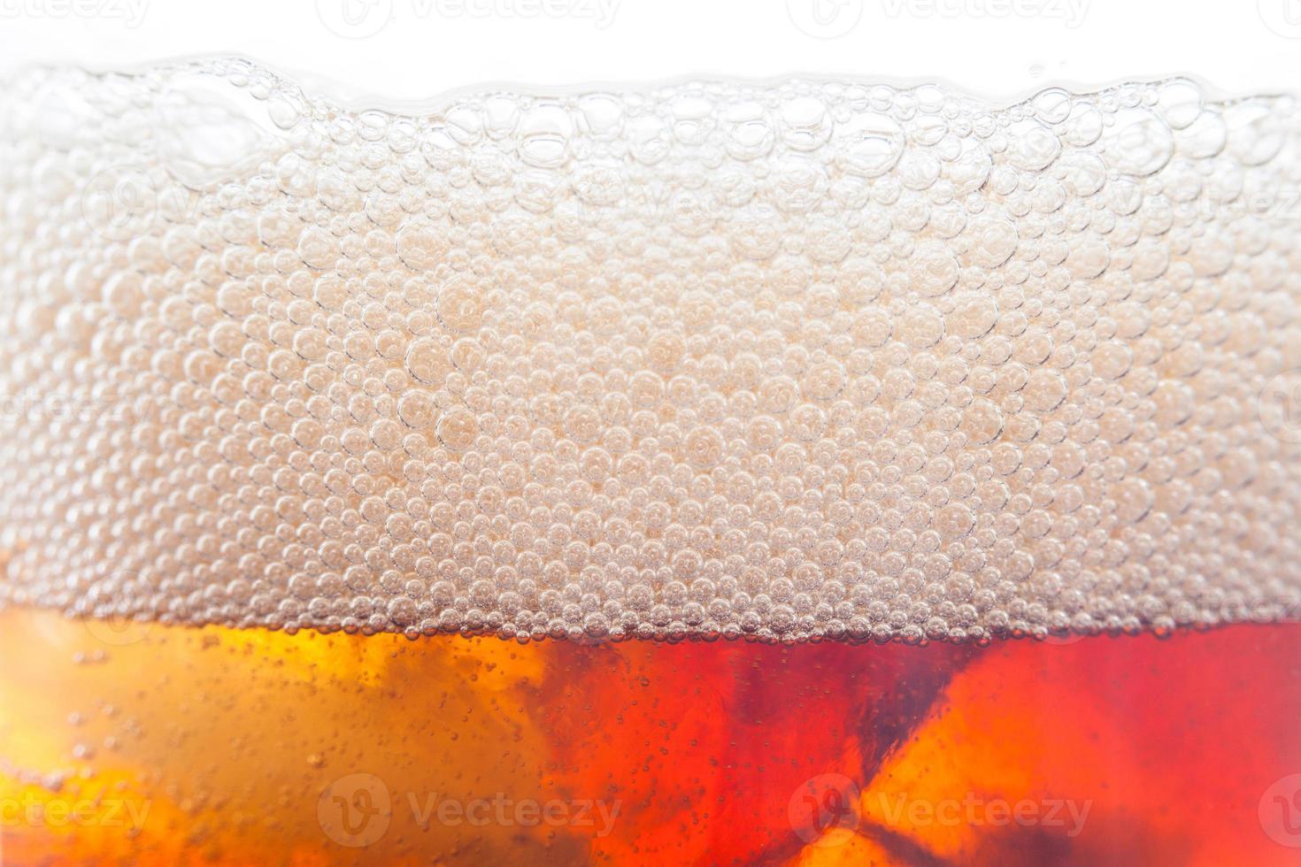 Blasenhintergrund vom Erfrischungsgetränk mit Eis foto
