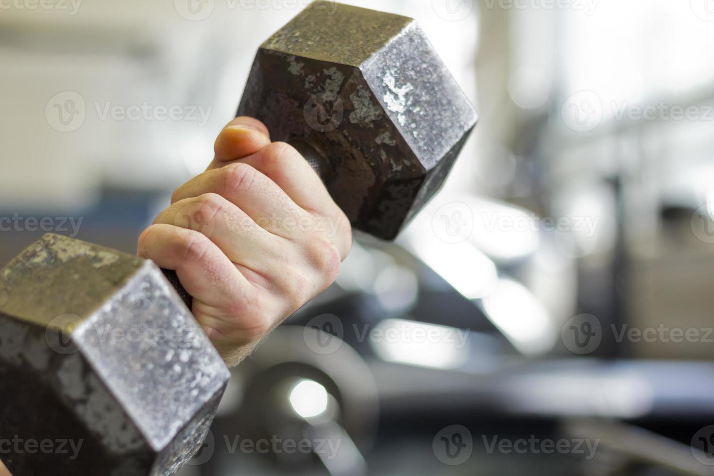 Hantelgewichte heben foto