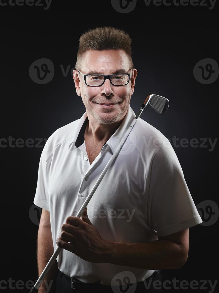 reifer Mann Golfer und Golfschläger foto
