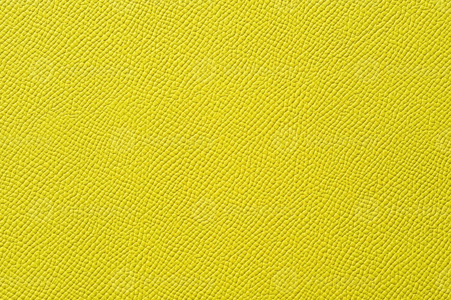 Nahaufnahme der nahtlosen gelben Lederstruktur foto