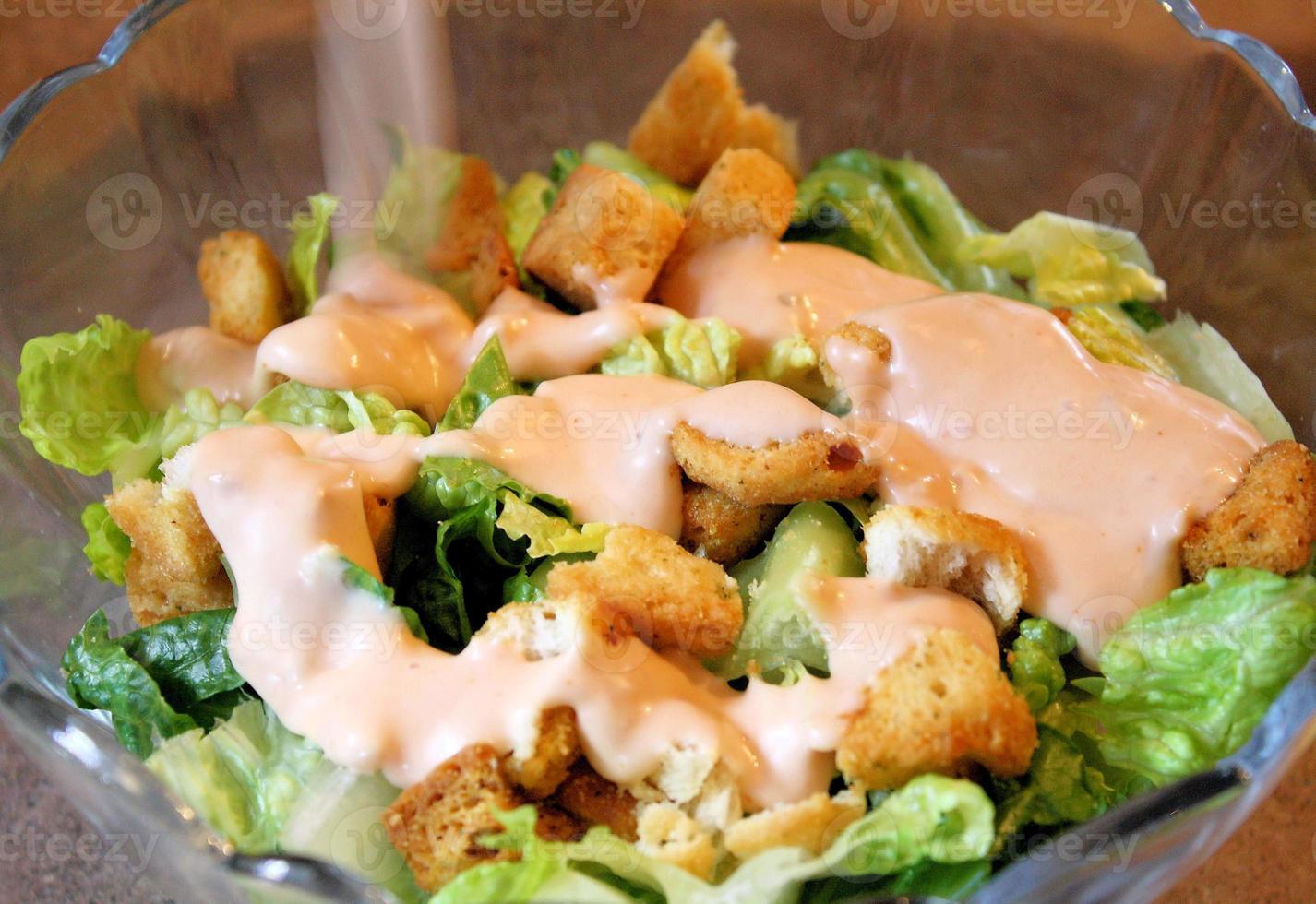Salat und Dressing foto