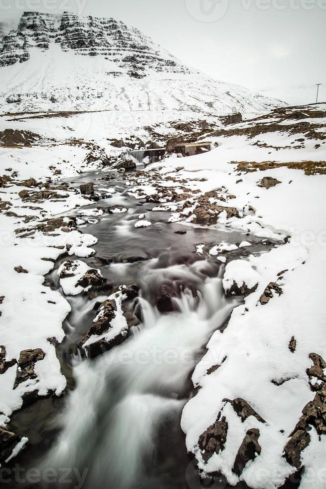 Winterwasserfall in Borgarfjordur foto