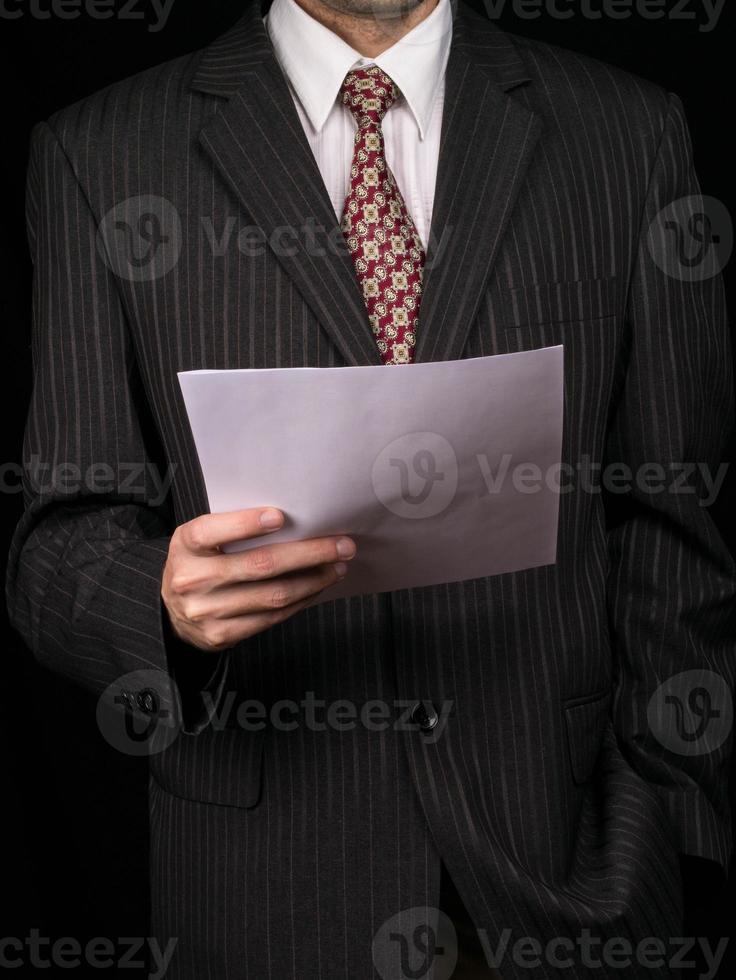 Geschäftsmann mit Bericht foto
