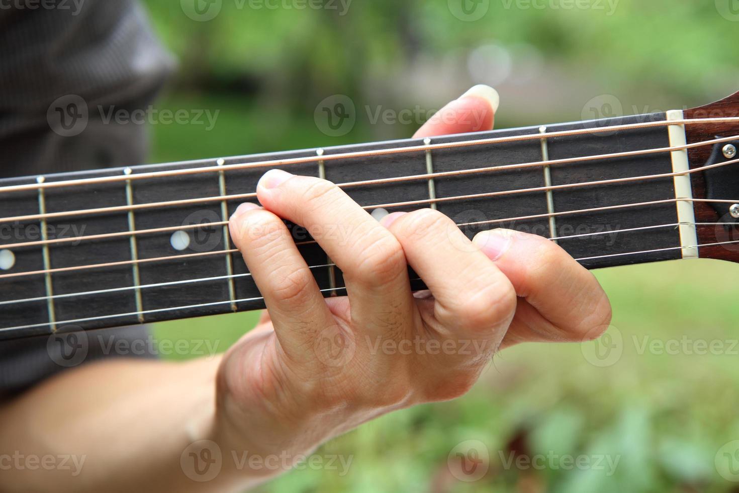 Gitarrenakkord spielen f # foto
