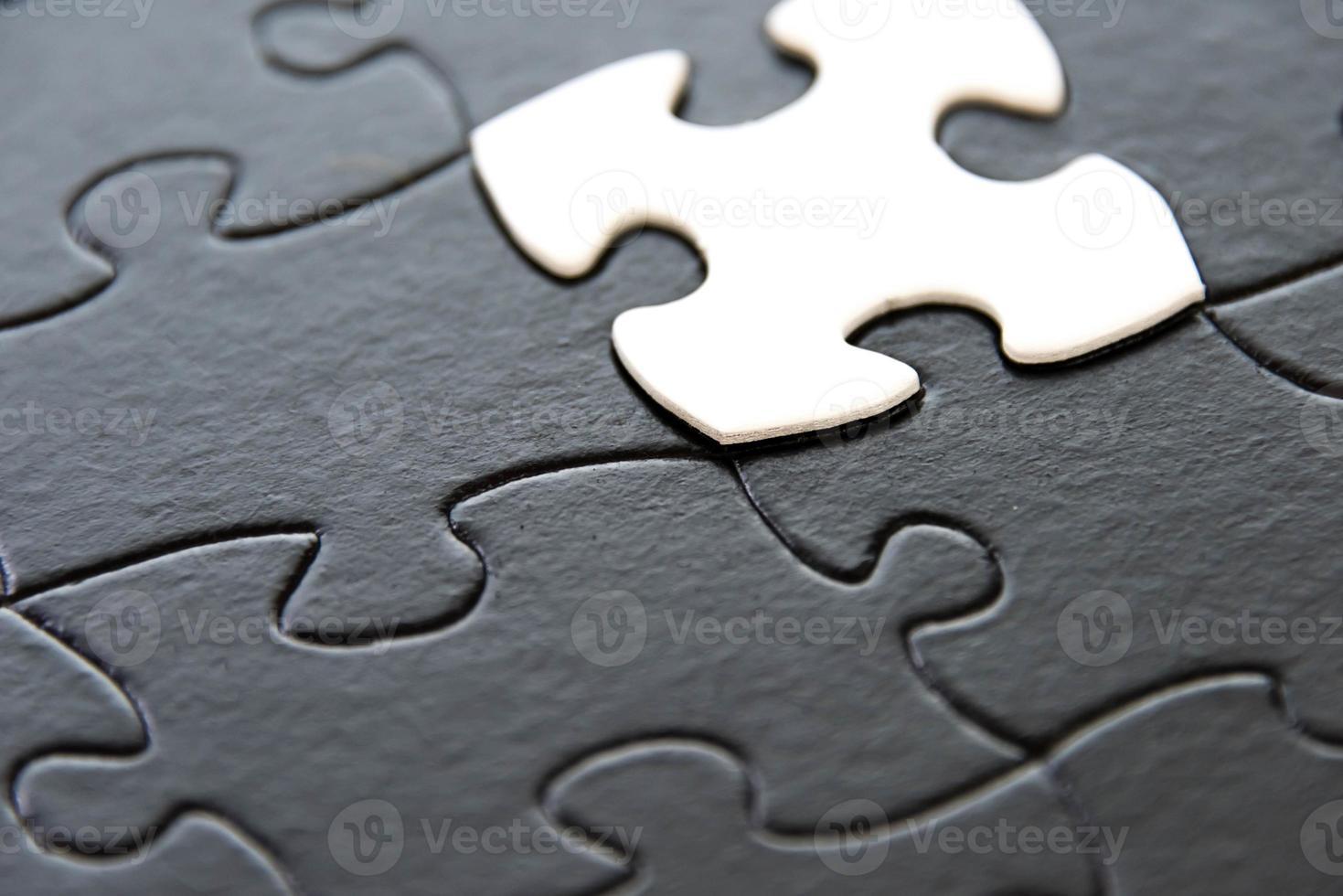 Schwarz-Weiß-Puzzleteile foto