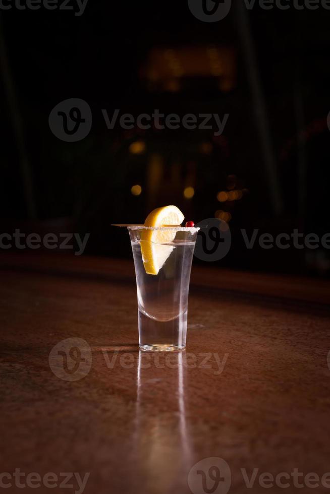 Tequila Schuss mit Zitrone foto