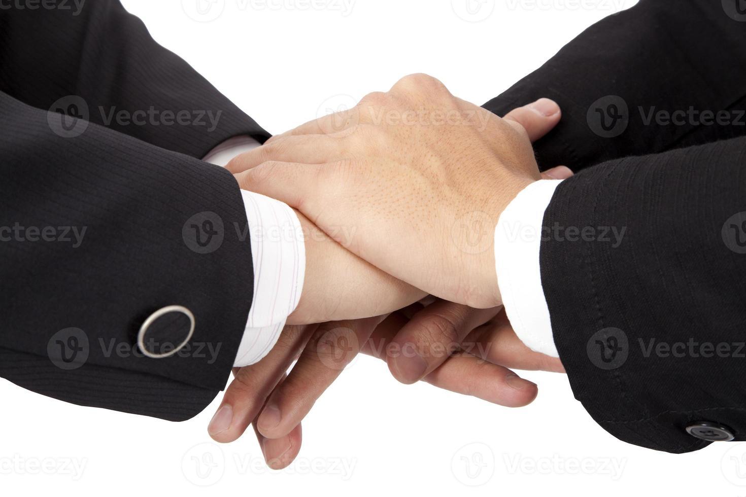 Vertrauens- und Kooperationskonzept. gestapelte Hände des Geschäftsmannes foto