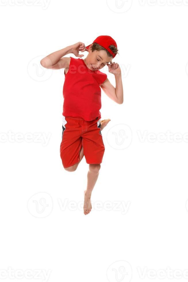 lustiges Gesicht Junge hüpfen foto